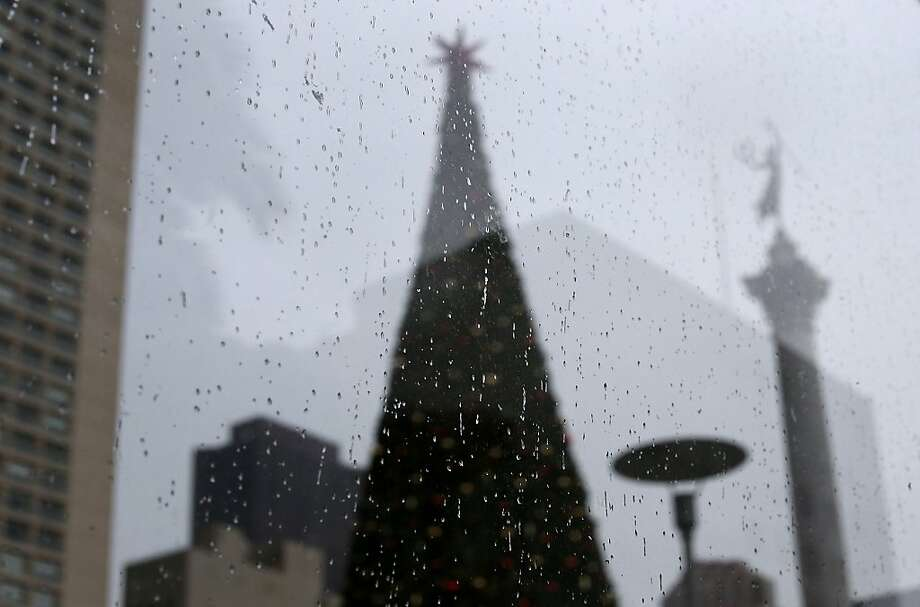 A holiday tree in Union Square is seen through a window on December 14, 2012 in San Francisco, California.  With less than two weeks before Christmas, San Franciscans are getting into the holiday spirit. Photo: Justin Sullivan, Getty Images