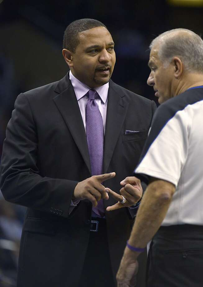 Golden State Warriors head coach Mark Jackson, left, talks to official Bennett Salvatore during a timeout in the second half of an NBA basketball game against the Orlando Magic in Orlando, Fla., Friday, Dec. 14, 2012. The Magic won 99-85.(AP Photo/Phelan M. Ebenhack) Photo: Phelan M. Ebenhack, Associated Press