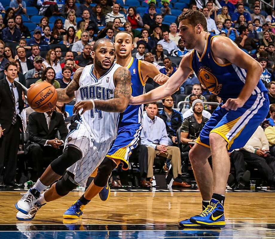 The Orlando Magic's Jameer Nelson (14) drives against the Golden State Warriors' David Lee during fourth-quarter action at Amway Center in Orlando, Florida, on Friday, December 14, 2012. Orlando topped Golden State, 99-85. (Joshua C. Cruey/Orlando Sentinel/MCT) Photo: Joshua C. Cruey, McClatchy-Tribune News Service