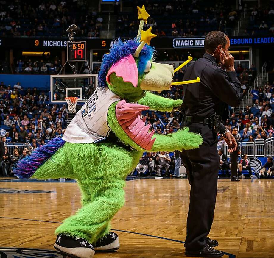 """What do you mean there's something behind me?"" Orlando Magic mascot, appropriately named Stuff, moments before terrorizing a security guard. Photo: Joshua C. Cruey, McClatchy-Tribune News Service"