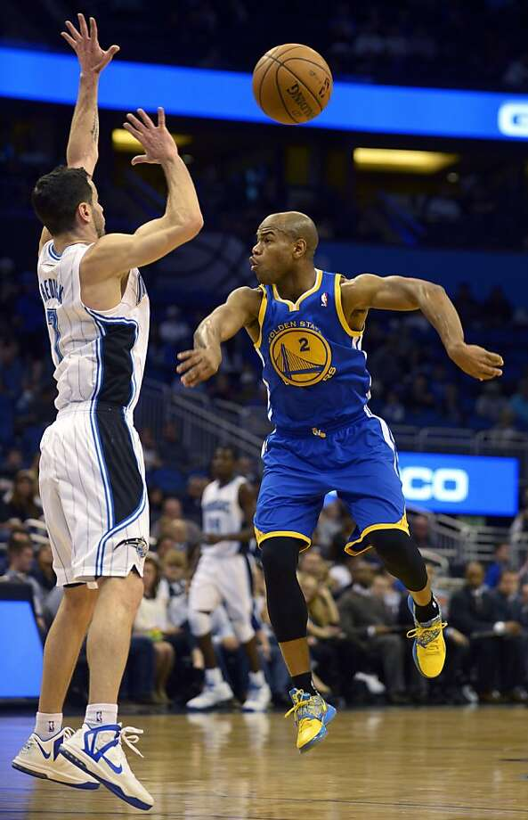 Golden State Warriors guard Jarrett Jack (2) does a no-look pass in front of Orlando Magic guard J.J. Redick during the first half of an NBA basketball game in Orlando, Fla., Friday, Dec. 14, 2012. (AP Photo/Phelan M. Ebenhack) Photo: Phelan M. Ebenhack, Associated Press