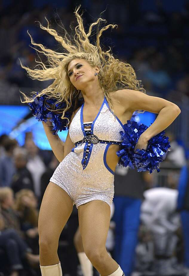 An Orlando Magic dancer performs during the second half of an NBA basketball game against the Golden State Warriors in Orlando, Fla., Friday, Dec. 14, 2012.(AP Photo/Phelan M. Ebenhack) Photo: Phelan M. Ebenhack, Associated Press