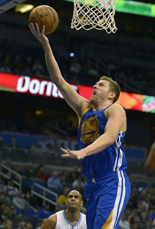Golden State Warriors forward David Lee (10) puts up a shot in front of Orlando Magic forward Arron Afflalo during the first half of an NBA basketball game in Orlando, Fla., Friday, Dec. 14, 2012. (AP Photo/Phelan M. Ebenhack) Photo: Phelan M. Ebenhack, Associated Press