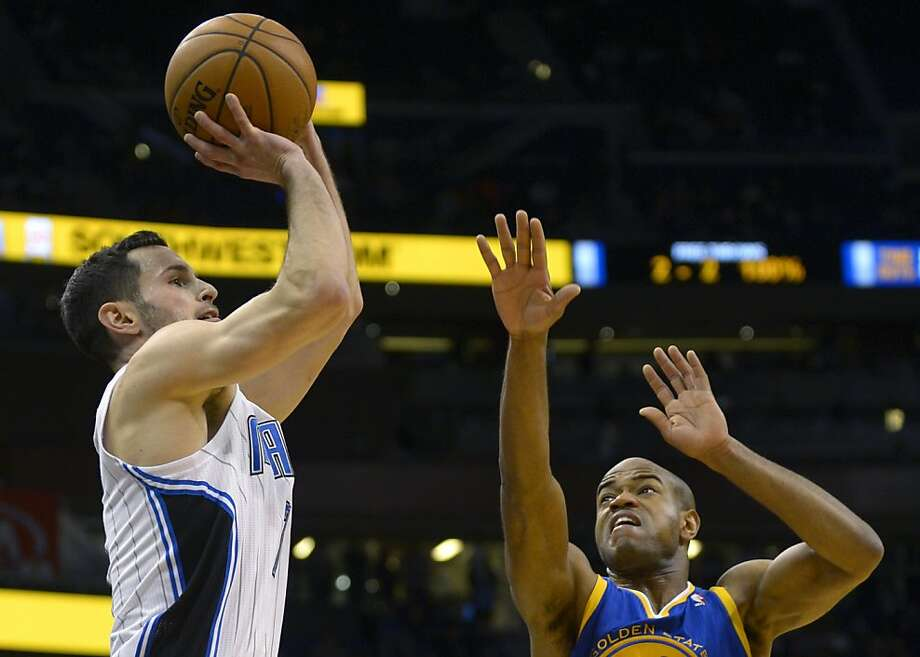 Orlando Magic guard J.J. Redick, left, puts up a shot in front of Golden State Warriors guard Jarrett Jack during the first half of an NBA basketball game in Orlando, Fla., Friday, Dec. 14, 2012.(AP Photo/Phelan M. Ebenhack) Photo: Phelan M. Ebenhack, Associated Press