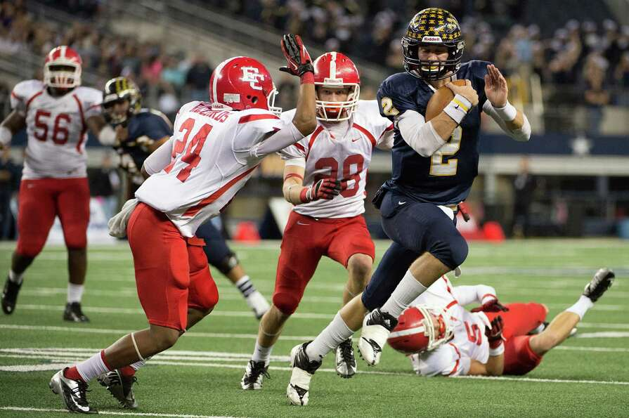 Stephenville quarterback Tyler Jones (2) breaks through the El Campo defense on a touchdown run duri