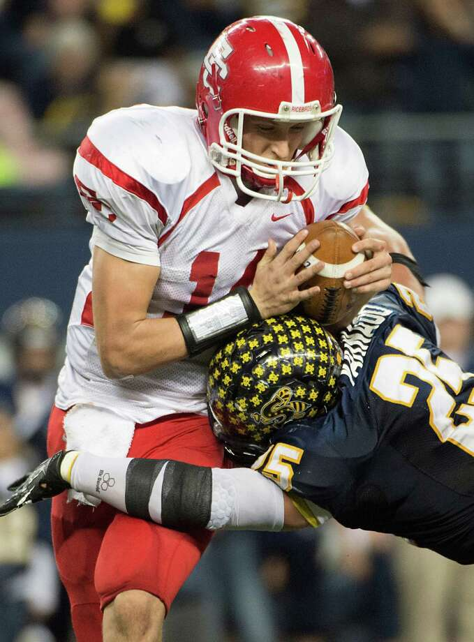 El Campo quarterback Bryce Brandl is dropped for a loss by Stephenville defensive end Chase Varnado. Photo: Smiley N. Pool, Houston Chronicle / © 2012  Houston Chronicle