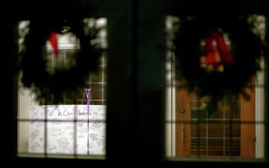 A message board stands in the entrance to the St. Rose of Lima Roman Catholic Church, Saturday, Dec. 15, 2012, in Newtown, Conn. A man killed his mother at their home and then opened fire Friday inside the elementary school where she taught, massacring 26 people, including 20 children, as youngsters cowered in fear to the sound of gunshots reverberating through the building and screams echoing over the intercom. Photo: AP
