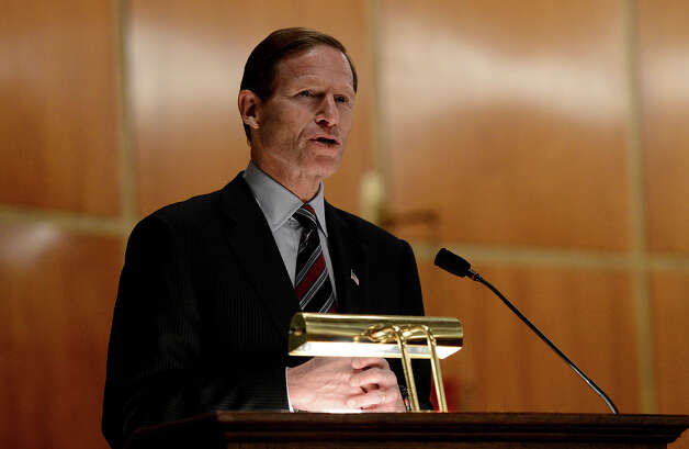 U.S. Sen. Richard Blumenthal speaks to mourners at a vigil service for victims of the Sandy Hook Elementary School shooting, at the St. Rose of Lima Roman Catholic Church in Newtown, Conn. Friday, Dec. 14, 2012. A man killed his mother at their home and then opened fire Friday inside the elementary school where she taught, massacring 26 people, including 20 children, as youngsters cowered in fear to the sound of gunshots reverberating through the building and screams echoing over the intercom Photo: AP
