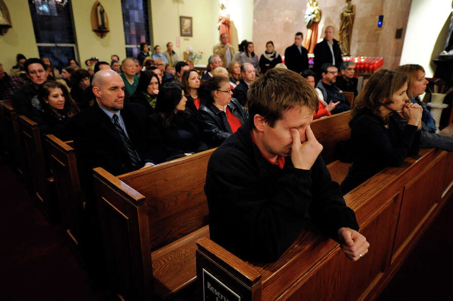 Mourners gather for a vigil service for victims of the Sandy Hook Elementary School shooting, at the