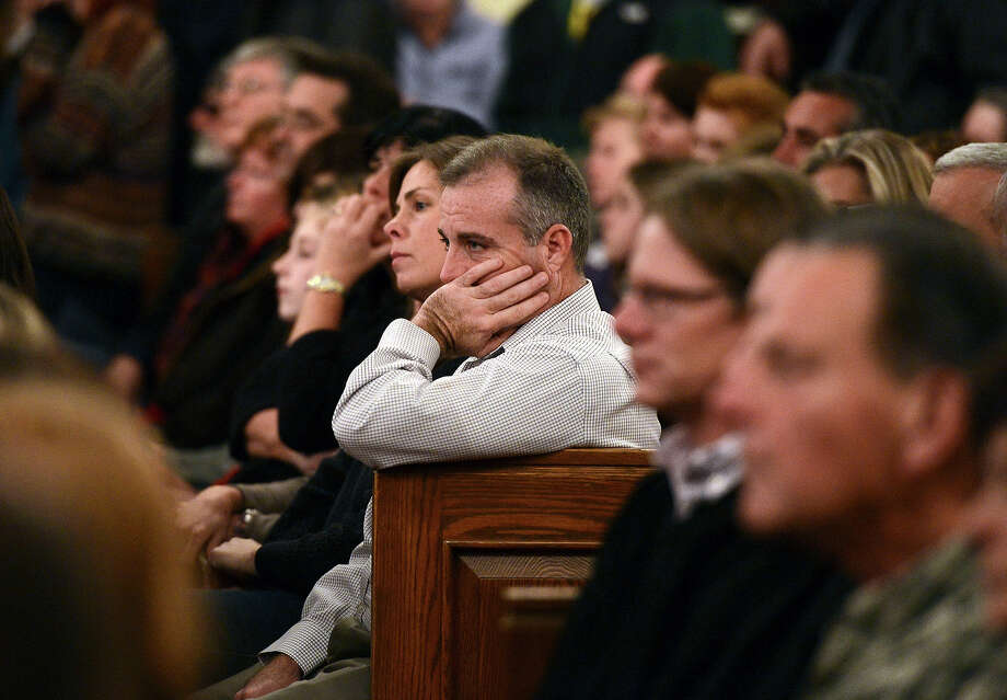 Mourners gather for a vigil service for victims of the Sandy Hook Elementary School shooting, at the St. Rose of Lima Roman Catholic Church in Newtown, Conn. Friday, Dec. 14, 2012. A man killed his mother at their home and then opened fire Friday inside the elementary school where she taught, massacring 26 people, including 20 children, as youngsters cowered in fear to the sound of gunshots reverberating through the building and screams echoing over the intercom Photo: AP