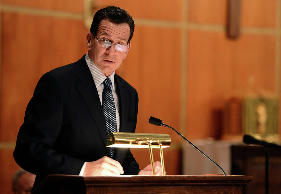 Connecticut Gov. Dannel Malloy speaks to mourners at a vigil service for victims of the Sandy Hook Elementary School shooting, at the St. Rose of Lima Roman Catholic Church in Newtown, Conn. Friday, Dec. 14, 2012. A man killed his mother at their home and then opened fire Friday inside the elementary school where she taught, massacring 26 people, including 20 children, as youngsters cowered in fear to the sound of gunshots reverberating through the building and screams echoing over the intercom Photo: AP