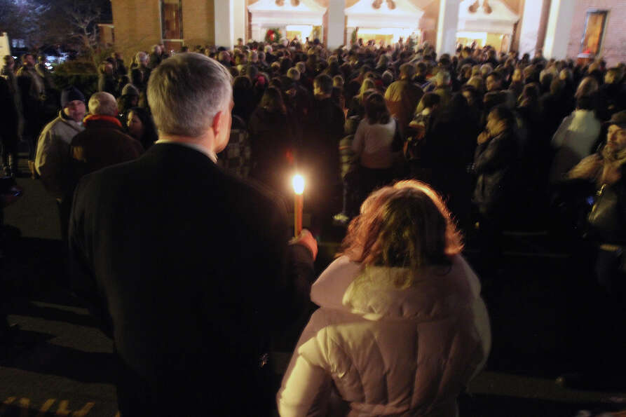 Thousands of people attend vigil at Saint Rose of Lima church at Saint Rose of Lima church, Friday,