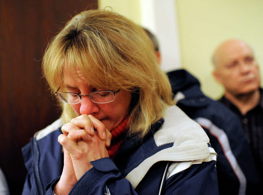 A mourner bows her head inside the St. Rose of Lima Roman Catholic Church at a vigil service for victims of the Sandy Hook Elementary School shooting, in Newtown, Conn. Friday, Dec. 14, 2012. Photo: AP