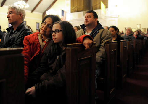 Mourners gather inside the St. Rose of Lima Roman Catholic Church at a vigil service for victims of the Sandy Hook Elementary School shooting that left at least 27 people dead, many of them young children, in Newtown, Conn. Friday, Dec. 14, 2012. Police have identified the gunman as Adam Lanza, whose mother was a teacher at the school. Photo: AP