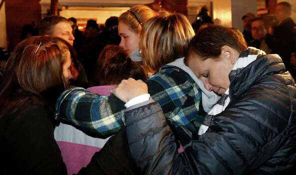 Girls embraces outside St. Rose of Lima Roman Catholic Church, which was filled to capacity, during a healing service held in for victims of an elementary school shooting in Newtown, Conn., Friday, Dec. 14, 2012. A gunman opened fire at Sandy Hook Elementary School in Newtown, killing 26 people, including 20 children. Photo: AP