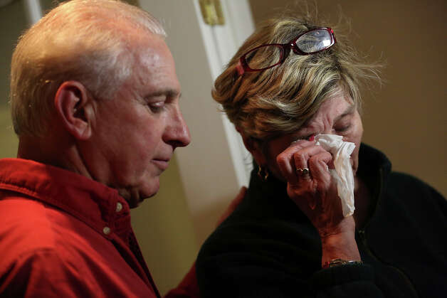 Ray Ruzek, left, consoles Shirley Towne as she speaks of the events of the day before a prayer meeting at the Heaven Ice Cream shop, Friday, Dec. 14, 2012 in Newtown, Conn. A gunman walked into the school Friday and opened fire, killing 26 people, including 20 children. Photo: AP