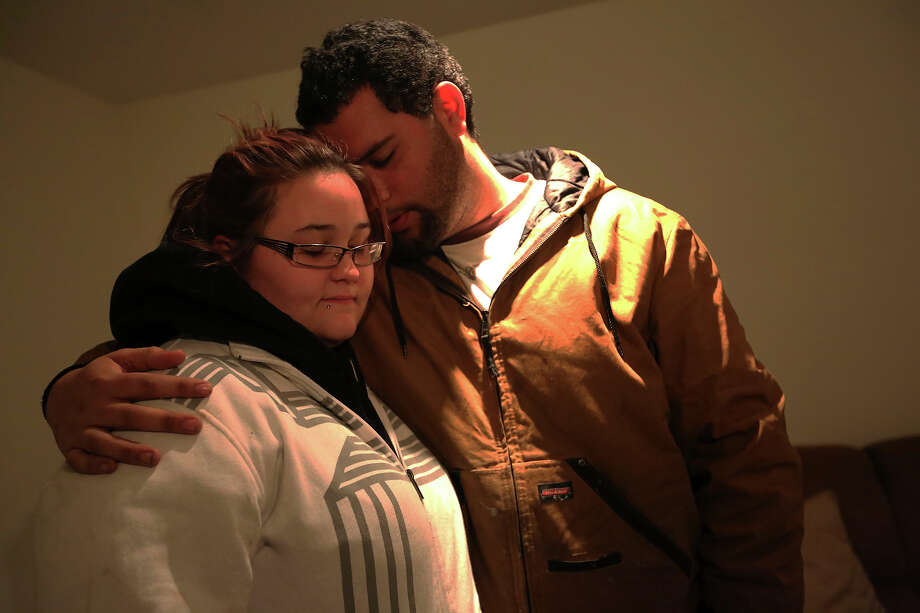 A couple embraces as they participate in a prayer meeting at the Heaven Ice Cream shop, Friday, Dec. 14, 2012 in Newtown, Conn. A gunman walked into the school Friday and opened fire, killing 26 people, including 20 children. Photo: AP