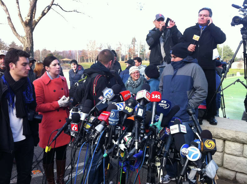 Media gather at Treadwell Park in Newtown, Conn. for a press briefing by State Police Lt. Paul Vance