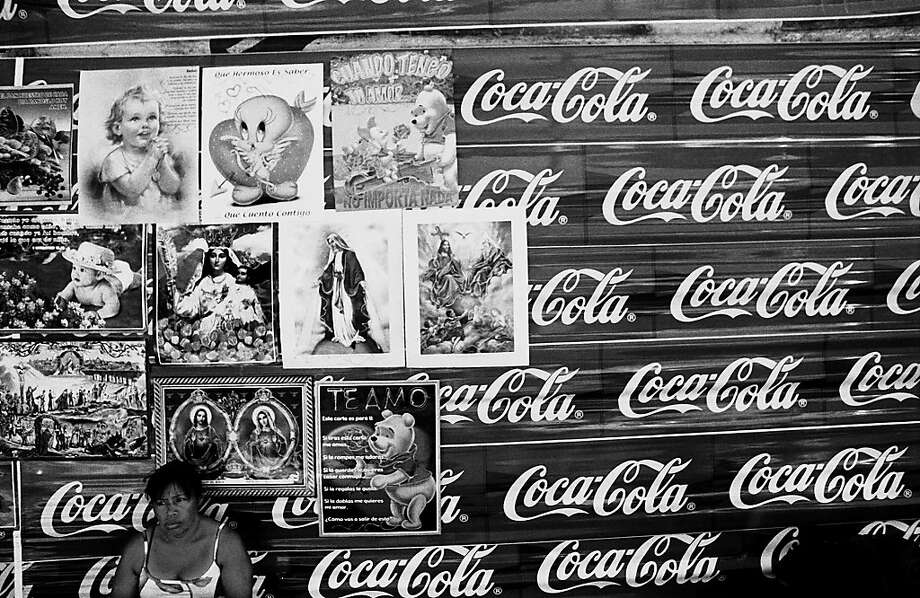 Religious images pasted on Coca-Cola packaging. Photo: Juan Carlos
