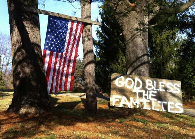 Signs of support are showing up all over the Sandy Hook area of Newtown, Conn. on Saturday, Dec. 15, 2012, a day after a mass shooting at Sandy Hook Elementary School. The shooter, Adam Lanza also died on the scene. Photo: Carol Kaliff / The News-Times