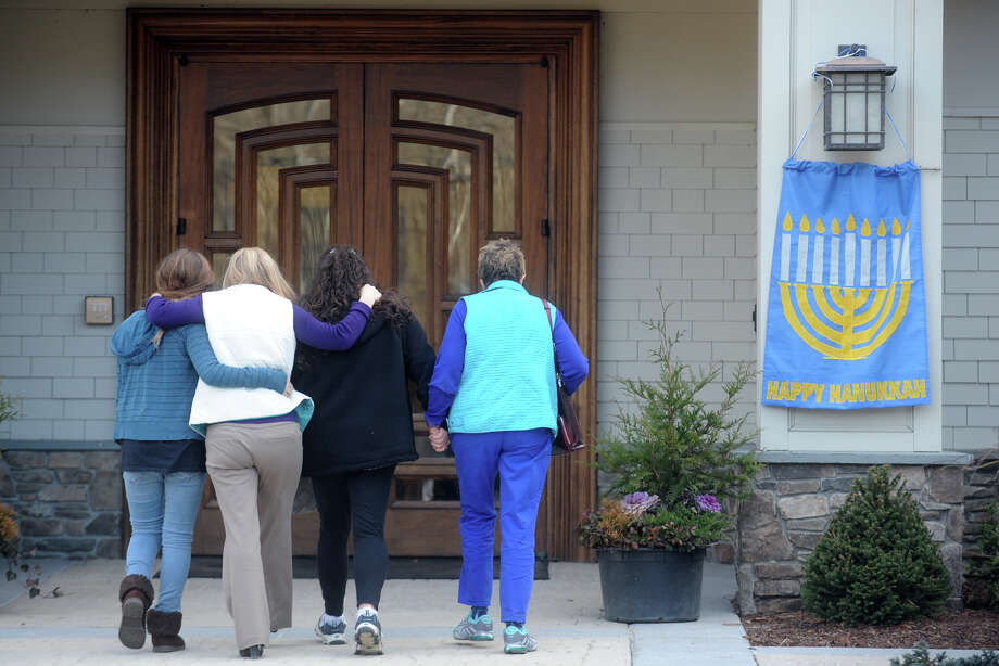 Congregants arrive for a prayer service at Adath Israel, in Newtown, Conn. Dec. 15th, 2012, the day after the mass shooting at Sandy Hook Elementary School where 27 people were killed. Photo: Ned Gerard / Connecticut Post