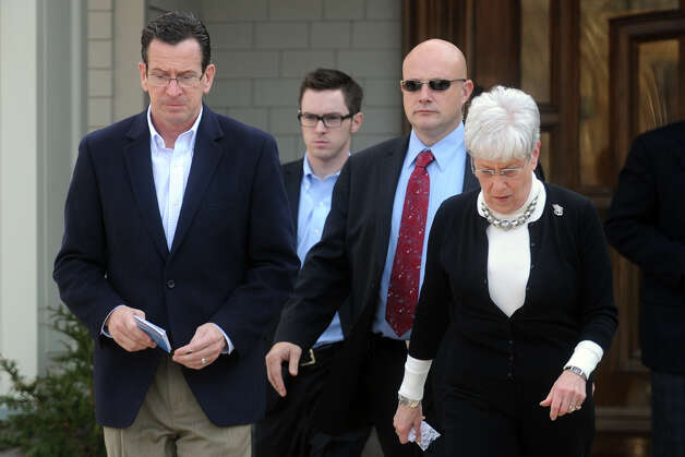 Gov. Dannel Malloy and Lt. Gov. Nancy Wyman leave Adath Israel following a Saturday prayer service in Newtown, Conn. Dec. 15th, 2012, the day after the mass shooting at Sandy Hook Elementary School where 27 people were killed. Photo: Ned Gerard / Connecticut Post