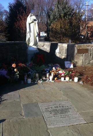 A memorial to the victims of the Sandy hook Elementary School massacre outside the Saint Rose of Lima Church in Newtown, Conn. on Saturday, Dec. 15, 2012. Photo: Amand Cuda, Amanda Cuda / Connecticut Post