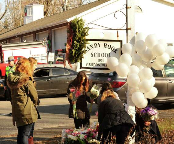 A memorial has been created near the site of the mass shooting at Sandy Hook Elementary School in Newtown Saturday Dec. 15, 2012. Photo: Michael Duffy