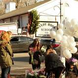 A memorial has been created near the site of the mass shooting at Sandy Hook Elementary School in Newtown Saturday Dec. 15, 2012.