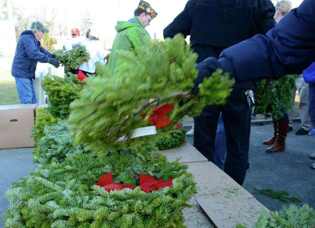 Seven hundred and sixty-one wreaths were given out at a rapid pace to the participants of the Wreaths Across America ceremony at the Veterans Cemetery in Darien. All were placed on our fallen soldiers' gravestones.  Dec. 15, 2012. Photo: Jeanna Petersen Shepard