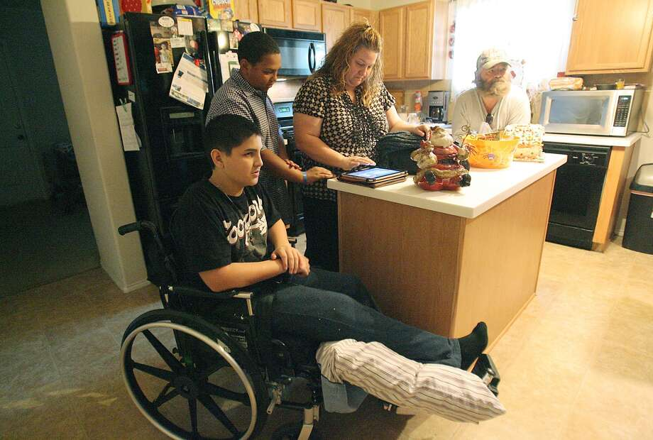 From left, Nicolas Tijerina, Cameron Richardson, Danna Ricahrdson and Donald Rex gather in Danna's house Dec.1, 2012 in Humble.