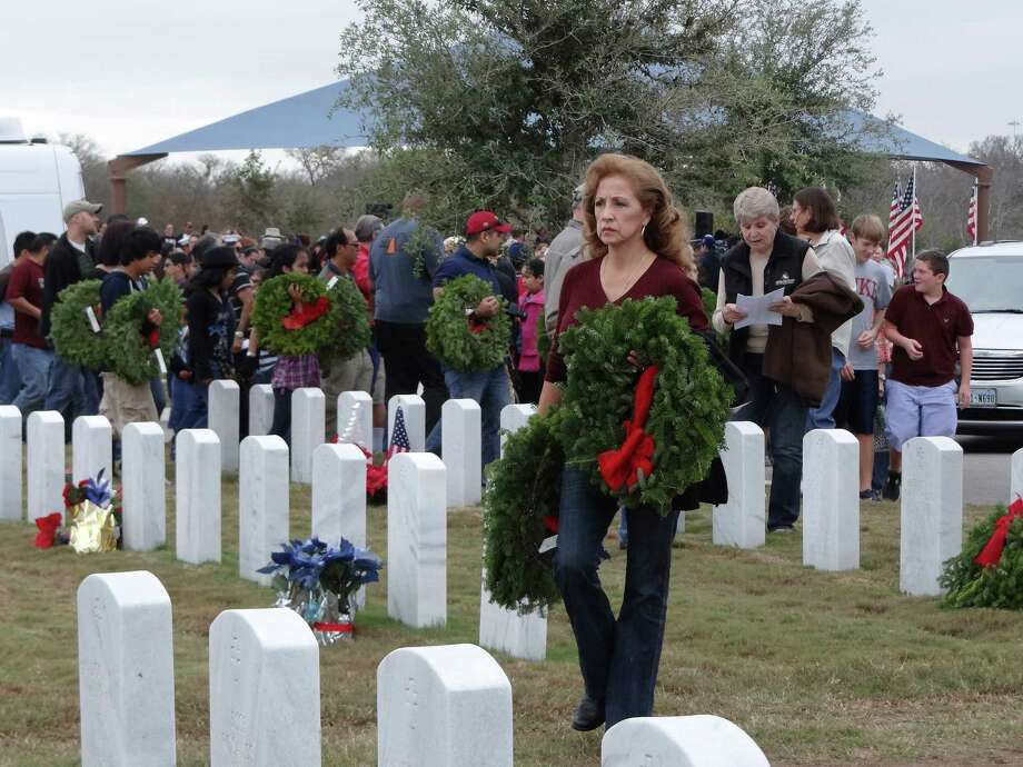 Miriam Madden participates in the Wreaths Across America event in 2012 at Fort Sam Houston. Photo: File Photo, Express-News / SAN ANTONIO EXPRESS-NEWS