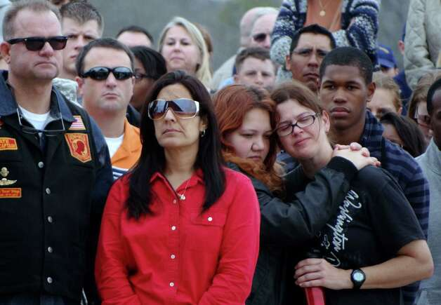 "The ceremony was attended by hundreds. ""This is all about every single one that's been laid to rest,"" a participant said. Photo: Billy Calzada, Express-News / SAN ANTONIO EXPRESS-NEWS"