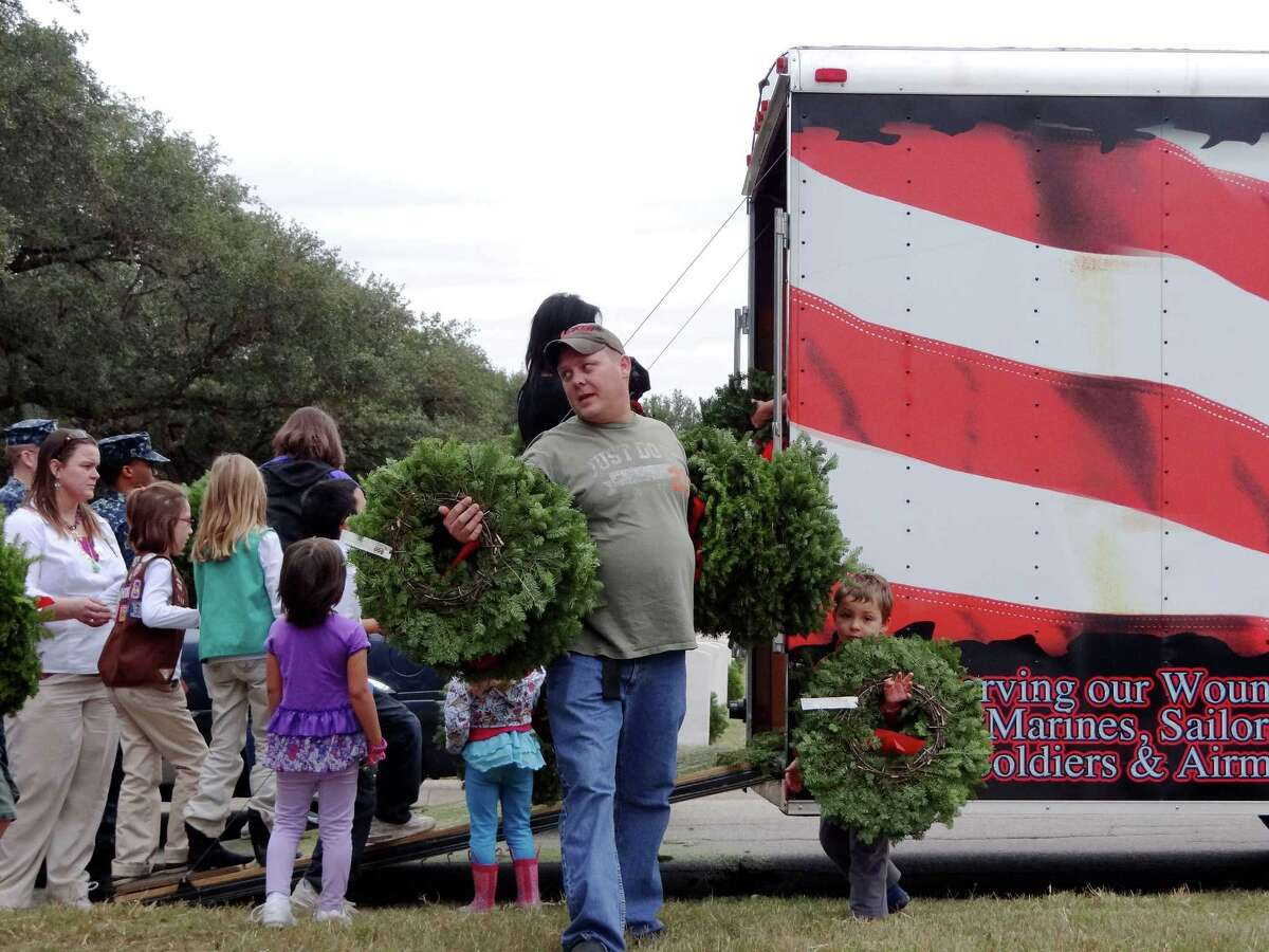 Volunteers collect wreaths to be placed on headstones of about 10,000 of the over 100,000 headstones at Fort Sam Houston National Cemetery during the Wreaths Across America event on Saturday, Dec. 15, 2012.