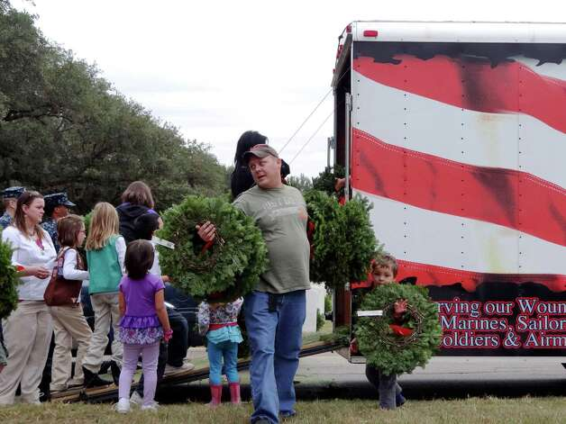 Volunteers collect wreaths to be placed on headstones of about 10,000 of the over 100,000 headstones at Fort Sam Houston National Cemetery during the Wreaths Across America event on Saturday, Dec. 15, 2012. Photo: Billy Calzada, Express-News / SAN ANTONIO EXPRESS-NEWS