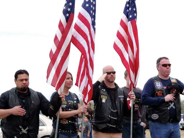 "Motorcyclists pay respects during the playing of ""Taps"" at the Wreaths Across America event at Fort Sam Houston National Cemetery on Saturday, Dec. 15, 2012. Photo: Billy Calzada, Express-News / SAN ANTONIO EXPRESS-NEWS"
