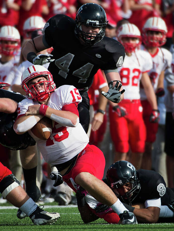 Katy quarterback Kiley Huddleston (15)] is brought down by Cibolo Steele defensive back John Burton (8) during the first quarter. Photo: Smiley N. Pool, Houston Chronicle / © 2012  Houston Chronicle