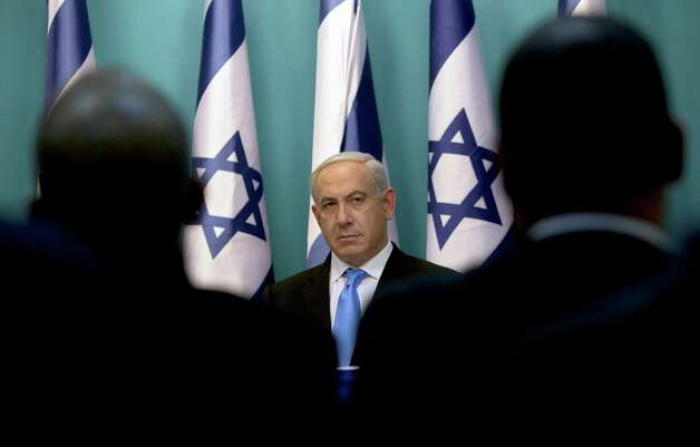FILE - in this Wednesday, Nov. 21, 2012 file photo Israeli Prime Minister Benjamin Netanyahu looks on during statements at the Prime Minister's office in Jerusalem. Peacemaking with the Palestinians, once the main issue by far in Israeli politics, has been strikingly absent from the campaign for next month's general election. After years of public frustration with failed peace efforts, Prime Minister Benjamin Netanyahu's badly divided challengers are trying instead to tap the economic frustrations of the middle class and a widespread resentment of perks enjoyed by fervently devout Jews.(AP Photo/Sebastian Scheiner, File) Photo: Sebastian Scheiner