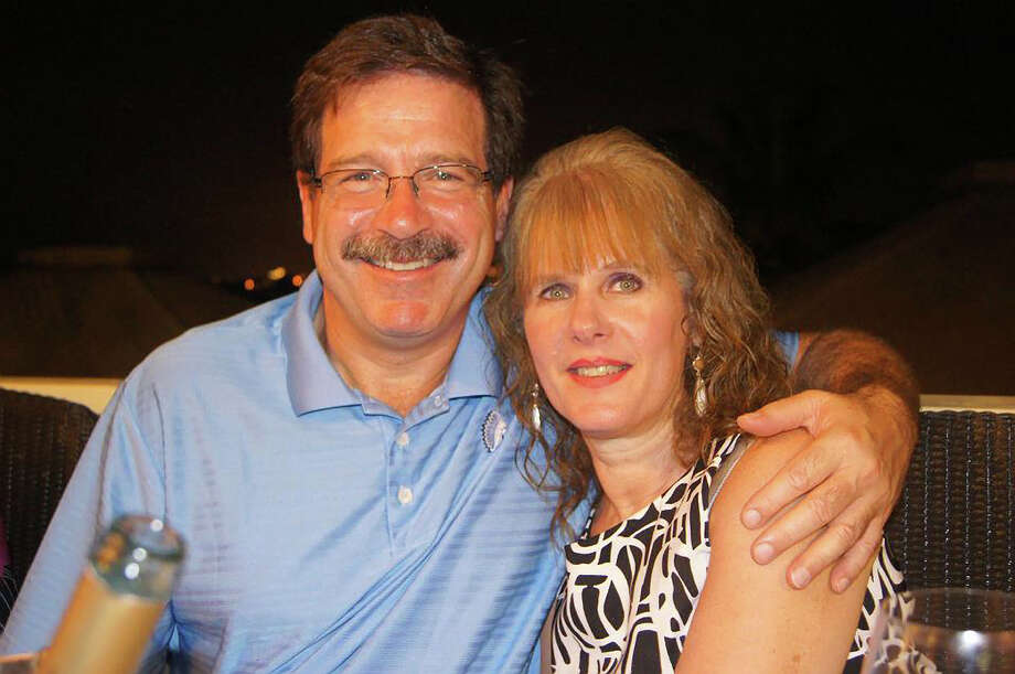 In this undated photo provided by Mark Sherlach, Mark Sherlach and his wife, school psychologist Mary Sherlach, pose for a photo. Mary Sherlach was killed Friday, Dec. 14, 2012, when a gunman opened fire at Sandy Hook Elementary School, in Newtown, Conn., killing 26 children and adults at the school. (AP Photo/Courtesy of Mark Sherlach) Photo: Uncredited, Associated Press / Courtesy of Mark Sherlach