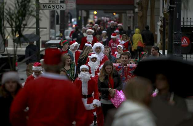 Santas walk the downtown of San Francisco as the annual Santacon event kicked off at Union Square and then turned to pub crawls around the city on Saturday Dec. 15, 2012 in San Francisco, Calif. Photo: Michael Macor, The Chronicle