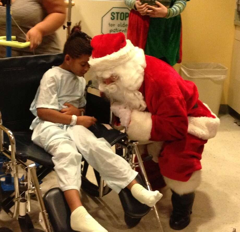 Art Nolan, a.k.a., Santa Claus, during a recent visit to see children at Albany Medical Center. (Photo provided by Polar Express Train Ride)