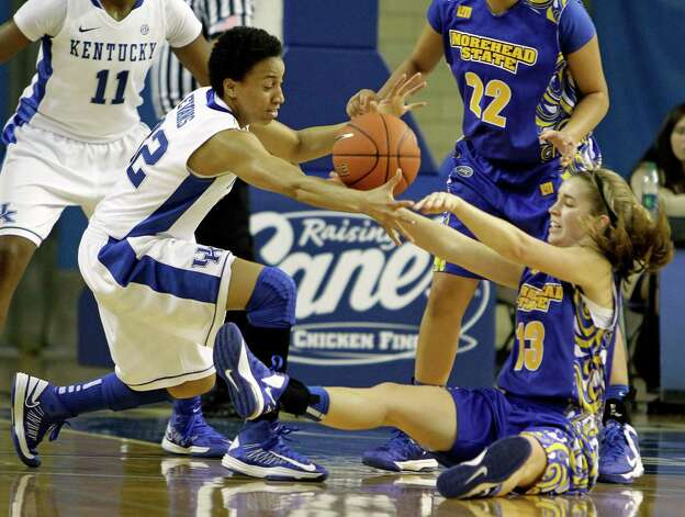 Kentucky Kastine Evans, left, battles Morehead State's Allie Turner (13) for a loose ball during an NCAA college basketball game in Lexington, Ky., Friday, Nov. 23, 2012. Kentucky won easily 73-37.  (AP Photo/Garry Jones) Photo: Garry Jones, Associated Press / FR50389 AP
