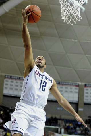 Connecticut's R.J. Evans goes up for a basket in the second half of an NCAA basketball game in Storrs, Conn., Tuesday, Nov. 13, 2012. Connecticut won 67-49. (AP Photo/Jessica Hill) Photo: Jessica Hill, Associated Press / FR125654 AP