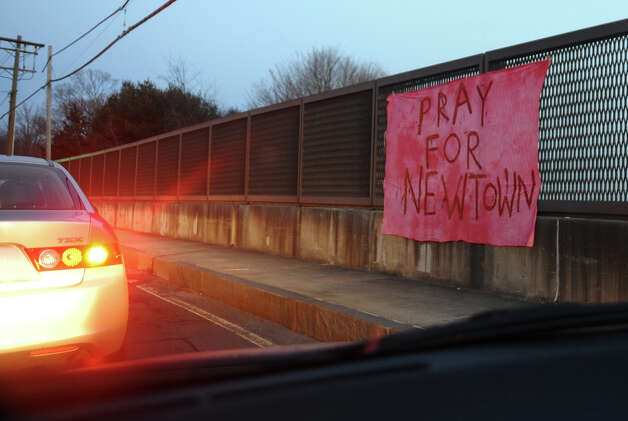 Impromptu memorials have been set up on the overpass at exit 10 off of I84 in Newtown, Conn. on Saturday December 2012. Yesterday's mass shooting at Sandy hook Elementary School left 28 dead, of which 20 were children. Photo: Christian Abraham / Connecticut Post