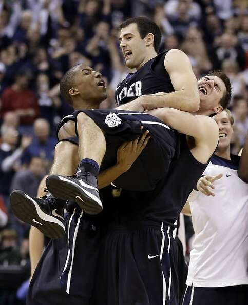 Guard Alex Barlow (center) is carried by teammates after Butler beat No. 1 Indiana 88-86 in overtime