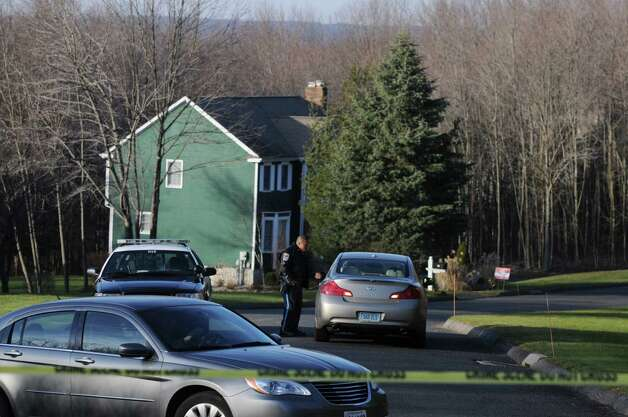 Police halted access to the Lanza home on Yogananda Street in Newtown Conn. Saturday Dec. 15, 2012. Adam Lanza, age 20, was identified by authorities as the killer who fatally shot his mother in her home before gunning down 20 children and 6 adults at Sandy Hook Elementary School in Newtown Conn. yesterday. Photo: Will Waldron, Hearst Connecticut Newspapers/Wi / The News-Times