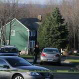 Police halted access to the Lanza home on Yogananda Street in Newtown Conn. Saturday Dec. 15, 2012. Adam Lanza, age 20, was identified by authorities as the killer who fatally shot his mother in her home before gunning down 20 children and 6 adults at Sandy Hook Elementary School in Newtown Conn. yesterday.