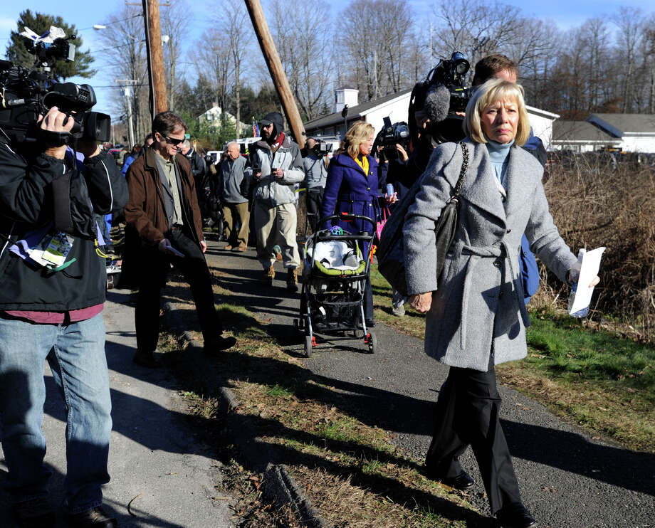Newtown Schools Superintendent Janet Robinson walks away after addressing the press near the entrance to the Sandy Hook Elementary School in the Sandy Hook section of Newtown, Saturday, Dec. 15, 2012. Photo: Carol Kaliff / The News-Times