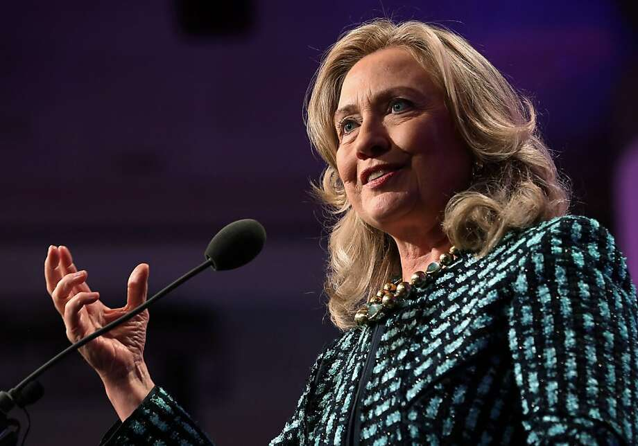 Secretary of State Hillary Rodham Clinton, seen here in September, is under the care of doctors as she recovers from a concussion and a stomach virus. Photo: John Moore, Getty Images
