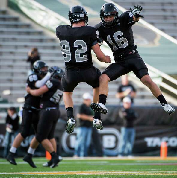Cibolo Steele defensive back Tyler Petoskey (16) and tight end Matthew Moen (82) celebrate after the